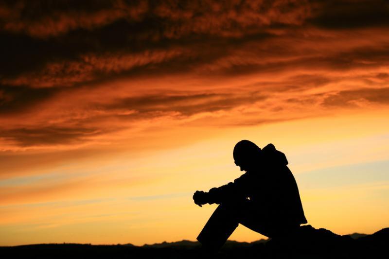 BA 155 - Man Thinking on the sunset
